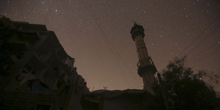 The night sky over a mosque in Aleppo. A huge blast washeard in a government-controlled rural region south of Aleppo on