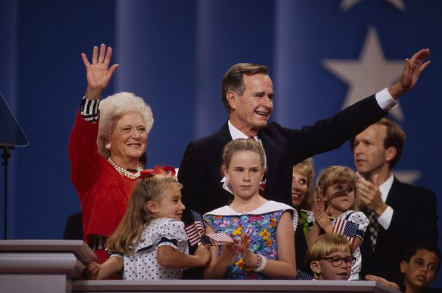 Barbara Bush and her husband, then-President George H.W. Bush, were surrounded by family members after...