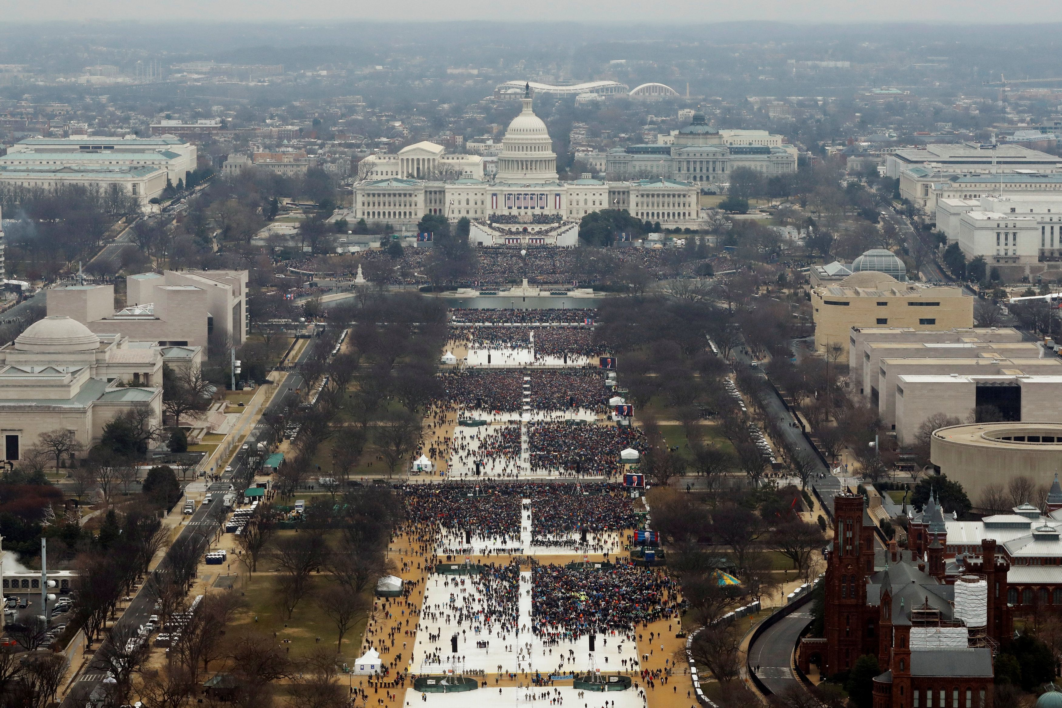 "Attendees partake in the inauguration ceremonies to swear in Donald Trump as the 45th president of the United States at the U.S. Capitol in Washington, U.S., January 20, 2017. Lucas Jackson: ""The assignment was simply to shoot the inauguration from the Washington Monument. To avoid confusion I made sure to transmit crowd pictures while Trump was onstage with the crowd at its peak. Twitter quickly erupted with claims that my images were taken early in the morning or photoshopped to remove attendees. At his first briefing, the President's new press secretary, Sean Spicer, said: ""Photographs of the inaugural proceedings were intentionally framed in a way, in one particular tweet, to minimize the enormous support that had gathered on the National Mall. This was also the first time that fencing and magnetometers went as far back on the Mall, preventing hundreds of thousands of people from being able to access the Mall as quickly as they had in inaugurations past."" This was not true. It was a new experience to have the validity of such a straightforward image questioned. After that press conference the picture was everywhere. Later, CNN released an image it took from the portico of the U.S. Capitol as Trump was sworn in. That vantage point is several hundred feet lower than the Washington Monument so the crowd looks bigger than in my picture. A second wave of 'liar' inundated me on Twitter. I ignored the noise but posted a copy of my image on Instagram with the caption: ""Perspective; it matters."" Later people noticed that the clock on the Smithsonian building in my picture shows the time at 1:15. Social media tried to claim my images were taken over an hour after the inauguration once the crowd had thinned. But the Smithsonian said its clock was broken and was stuck on that time."" REUTERS/Lucas Jackson/File photo  SEARCH ""POY STORY"" FOR THIS STORY. SEARCH ""REUTERS POY"" FOR ALL BEST OF 2017 PACKAGES. TPX IMAGES OF THE DAY."