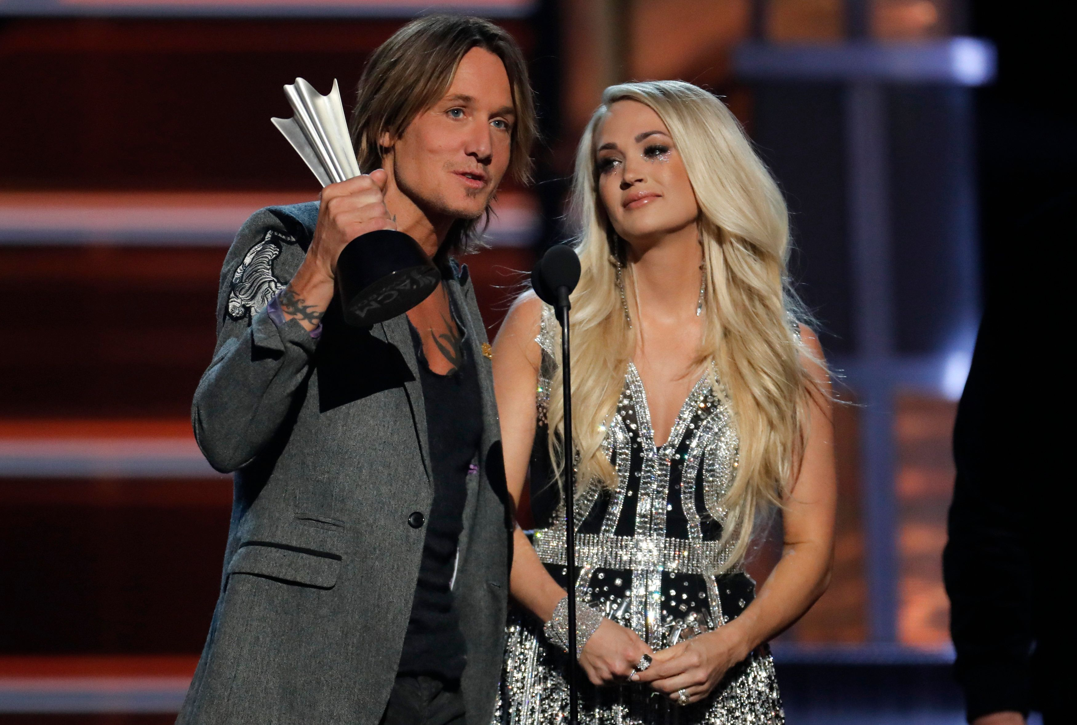 """Keith Urban and Carrie Underwoodwon the award for Vocal Event of the Year for """"The Fighter"""" at the53rd Academy of"""