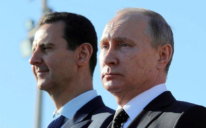 <strong>Russian President Vladimir Putin (R) and Syrian President Bashar al-Assad visit the Hmeymim air base in Latakia Province, Syria December 11, 2017.</strong>