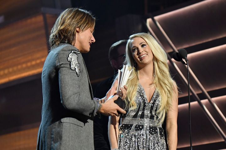 Keith Urban and Carrie Underwood accept the vocal event of the year award at the Academy of Country Music Awards.