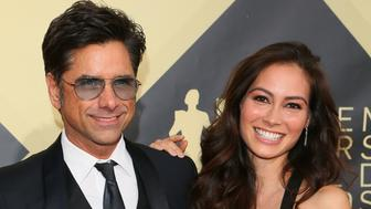 John Stamos and Caitlin McHugh arrive for the 24th Annual Screen Actors Guild Awards at the Shrine Exposition Center on January 21, 2018, in Los Angeles, California. / AFP PHOTO / Jean-Baptiste LACROIX        (Photo credit should read JEAN-BAPTISTE LACROIX/AFP/Getty Images)