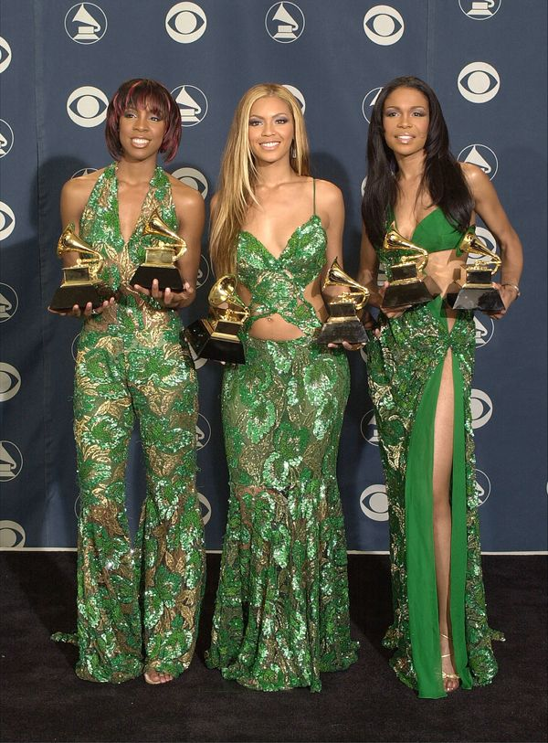 Posing withtheir awards at the 43rd annual Grammy Awards at Staples Center in Los Angeles.