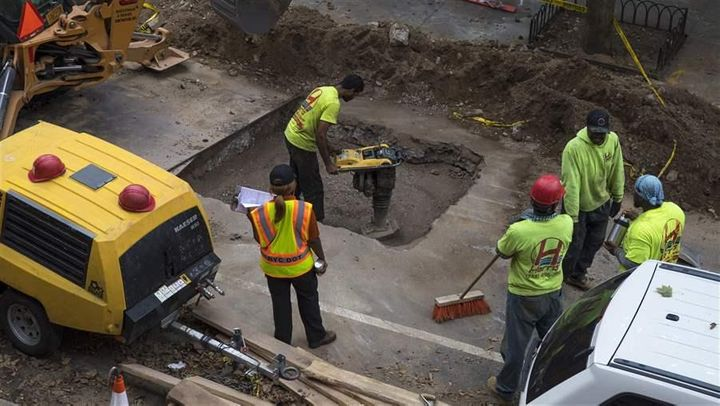 Contractors repair an underground sewer pipe in Brooklyn, New York. A new study aims to track sound across the city.