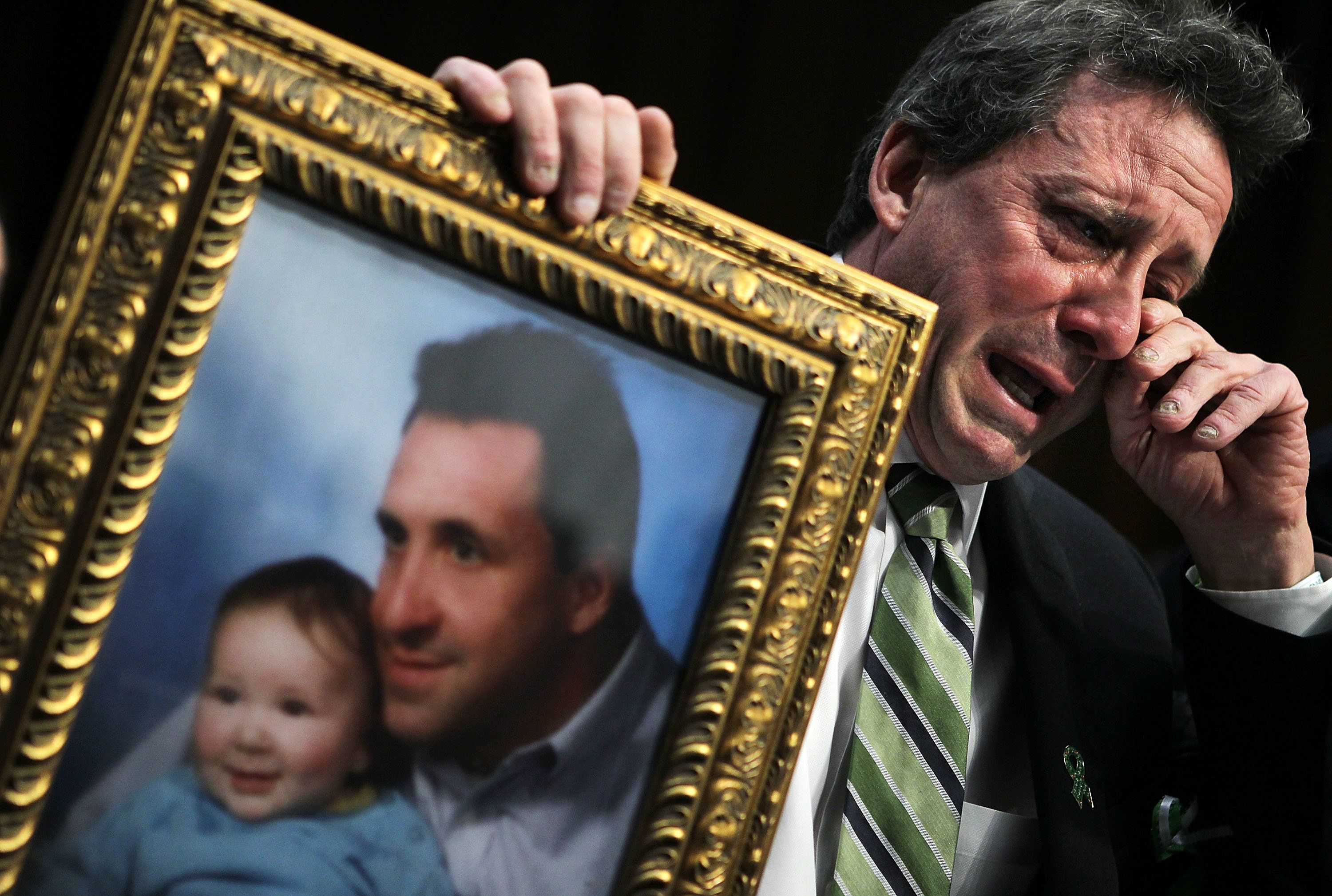 WASHINGTON, DC - FEBRUARY 27:  Neil Heslin, father of six-year-old Sandy Hook Elementary School shooting victim Jesse Lewis, wipes tears as he testifies during a hearing before the Senate Judiciary Committee February 27, 2013 on Capitol Hill in Washington, DC. The committee held a hearing on 'The Assault Weapons Ban of 2013.'  (Photo by Alex Wong/Getty Images)