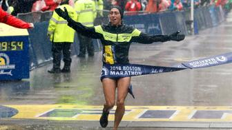 Apr 16, 2018; Boston, MA, USA; Desiree Linden of the USA hits the tape to win the Women's Division of the 2018 Boston Marathon. Mandatory Credit: Winslow Townson-USA TODAY Sports