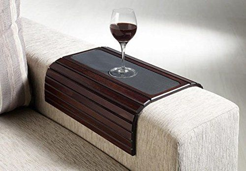 """This table fits almost any armchair, creating a flat surface to hold her drink of choice. Get it <a href=""""https://www.amazon."""