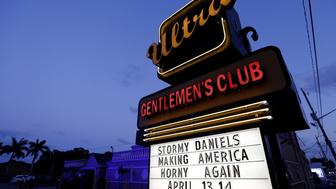 A sign announces appearances by Stephanie Clifford, who uses the stage name Stormy Daniels, at the Ultra Gentleman's Club in West Palm Beach,  Florida, U.S., April 13, 2018.  REUTERS/Joe Skipper