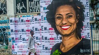 A wheat-paste piece of street art by artist Luis Bueno shows the councilwoman from Rio de Janeiro Marielle Franco. On March 14th, the councilwoman from Rio de Janeiro Marielle Franco and her driver Anderson Gomes, were shot dead in the heart of Rio. The crime is still unsolved, but the investigations point to the participation of cops. Marielle was a critic of police violence, which affects mainly the poor population of Rio de Janeiro. She was also very critic of the military intervention that took place in Rio on the last month.  (Photo by Cris Faga/NurPhoto via Getty Images)