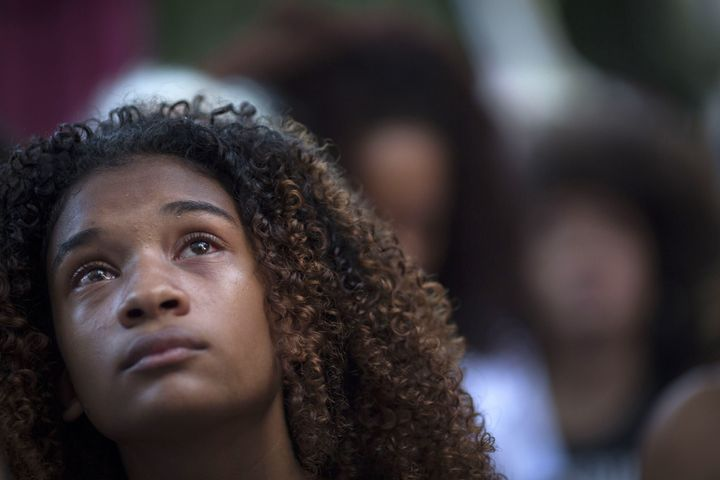 A protester cries during a March 20 demonstration against the killing of Marielle Franco in front of the Municipal Chamb