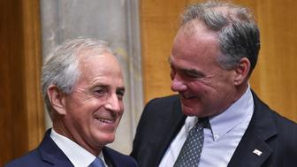 Senate Foreign Relations Committee Chair Senator Bob Corker (L), R-TN, speaks with Senator Tim Kaine, D-VA, during a committee hearing on global efforts to defeat ISIS on Capitol Hill in Washington, DC on June 28, 2016. / AFP / MANDEL NGAN        (Photo credit should read MANDEL NGAN/AFP/Getty Images)