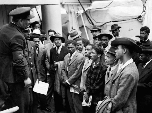 File photo dated 22/06/48 of Jamaican immigrants being welcomed by RAF officials from the Colonial Office...