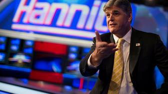 "Fox News Channel anchor Sean Hannity poses for photographs as he sits on the set of his show ""Hannity"" at the Fox News Channel's studios in New York City, October 28, 2014.  REUTERS/Mike Segar   (UNITED STATES - Tags: MEDIA POLITICS ENTERTAINMENT)"