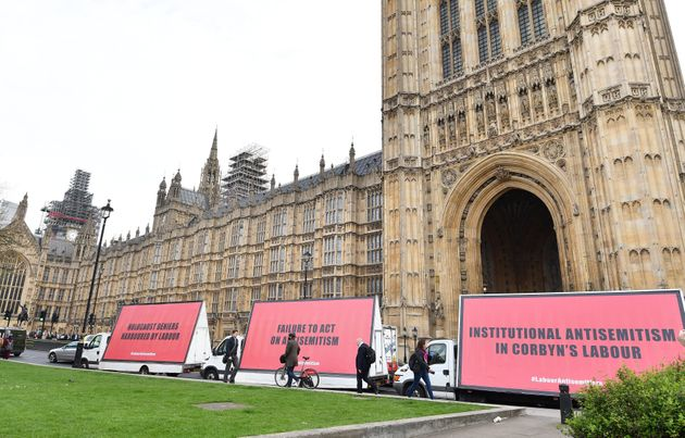 A convoy of three billboard advertising vans with message for Jeremy Corbyn and the Labour party, pass...