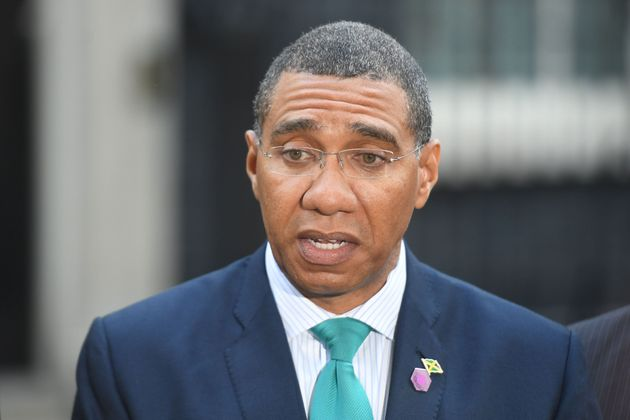 The Prime Minister of Jamaica Andrew Holness talks to the waiting media in arriving in Downing Street...