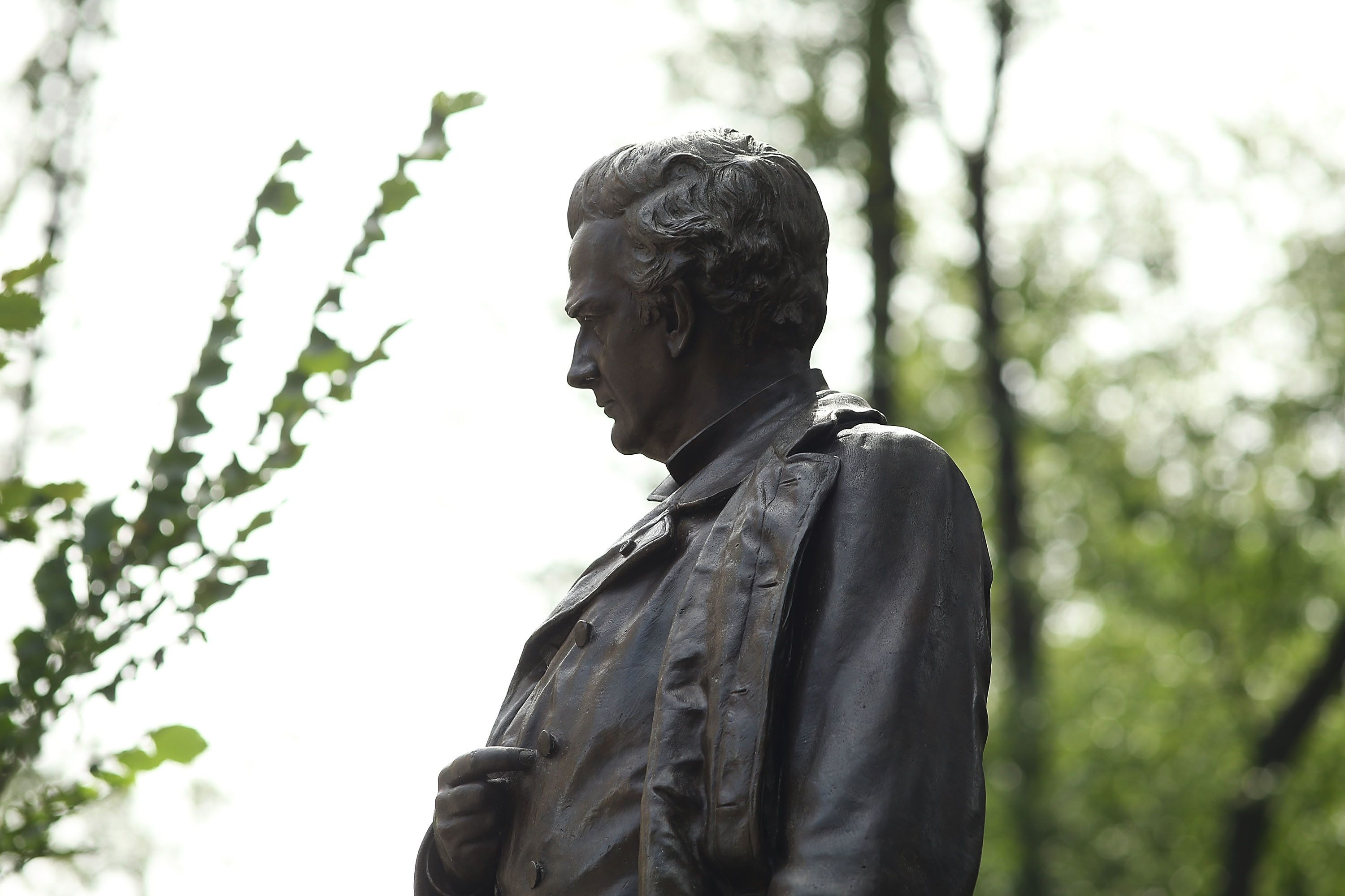 NEW YORK, NY - AUGUST 23:  A statue of J. Marion Sims, a surgeon celebrated by many as the father of modern gynecology, stands along an upper Manhattan street on August 23, 2017 in New York City. Following the recent violence in Charlottesville, many politicians, activists and citizens are calling for monuments dedicated to Confederate-era and other controversial figures to be taken down. Many of Sims medical breakthroughs came from experimenting on black slaves without anesthesia.  (Photo by Spencer Platt/Getty Images)
