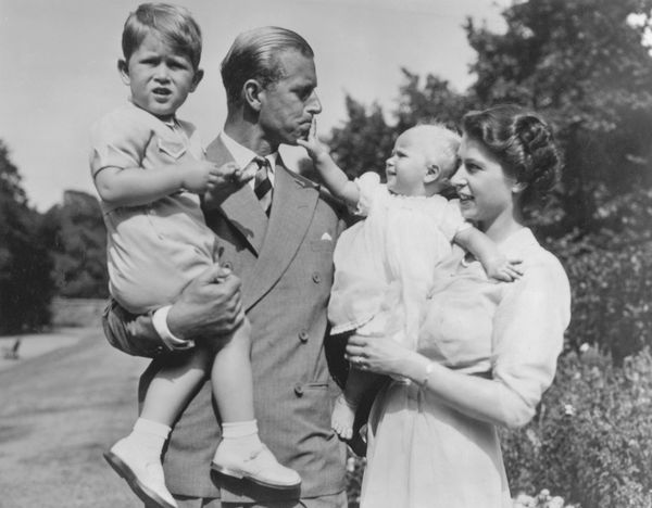 In 1950, Elizabeth and Philip welcomed a daughter, Princess Anne. She is pictured here with her parents and her older brother