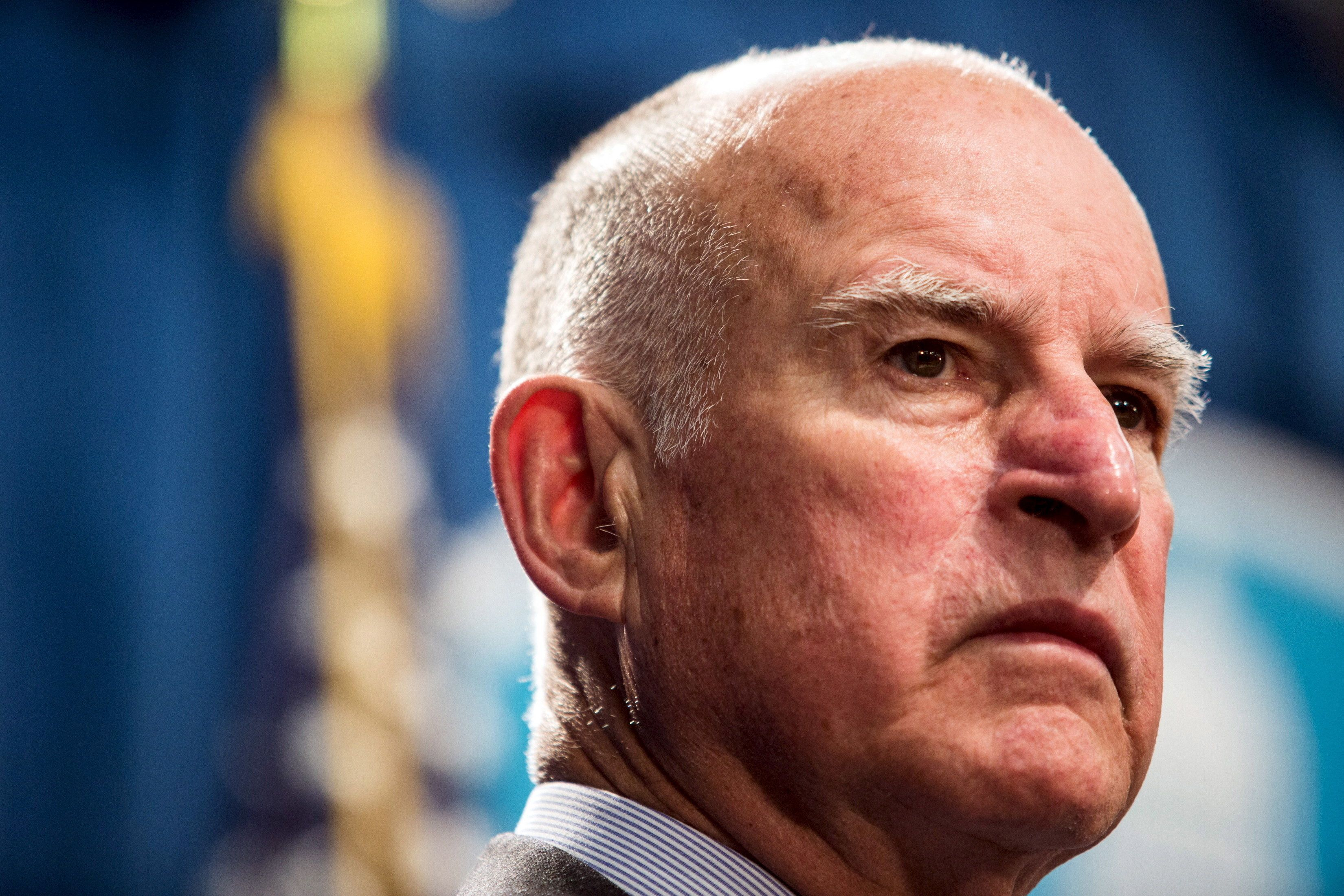 California Governor Jerry Brown looks on during a news conference at the State Capitol in Sacramento, California in this file photo taken March 19, 2015. Brown on April 4, 2016 was expected to sign into a law a plan to raise the minimum wage from $10 to $15 an hour by the year 2023, making the nation's most-populous state the first to boost pay to that level for the working poor.  REUTERS/Max Whittaker/Files