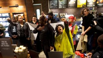 Protestors demonstrate inside a Center City Starbucks, where two black men were arrested, in Philadelphia, Pennsylvania U.S., April 16, 2018.  REUTERS/Mark Makela