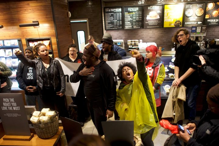 Demonstrators inside a Starbucks in Philadelphia on Monday, protesting after two black men were arrested in the store la