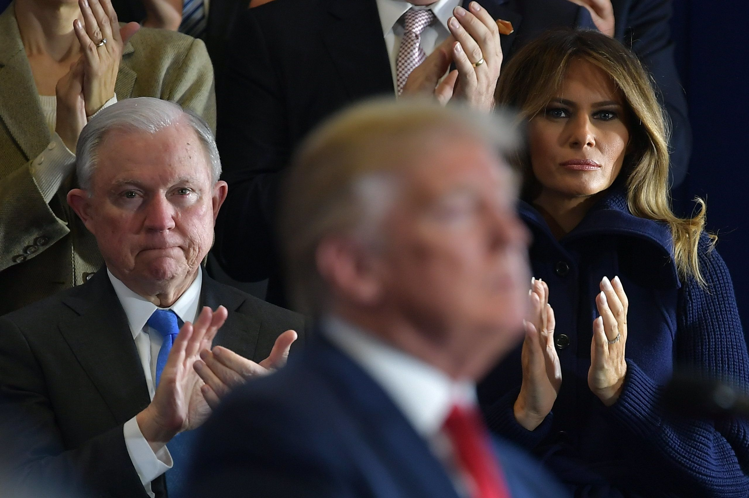 Attorney General Jeff Sessions(L) and First Lady Melania Trump applaud as US President Donald Trump speaks about combating the opioid crisis at Manchester Community College in Manchester, New Hampshire on March 19, 2018. / AFP PHOTO / MANDEL NGAN        (Photo credit should read MANDEL NGAN/AFP/Getty Images)