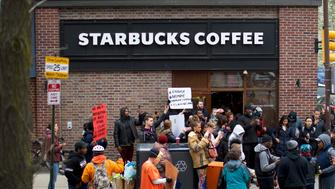PHILADELPHIA, PA - APRIL 15:  Protestors demonstrate outside a Center City Starbucks on April 15, 2018 in Philadelphia, Pennsylvania. Police arrested two black men who were waiting inside the Center City Starbucks which prompted an apology from the company's CEO.  (Photo by Mark Makela/Getty Images)