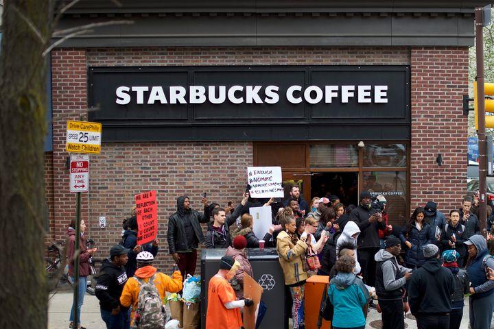 Protesters demonstrate on Sunday outside the Philadelphia Starbuckswhere two black men were arrested last week.