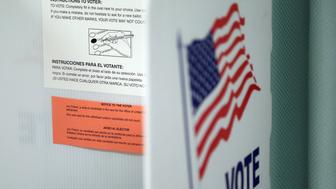 Instructions in both English and Spanish on how to vote are affixed to a booth inside a polling station in Christmas, Florida prior to the arrival of voters on election day, on November 8, 2016. After an exhausting, wild, bitter, and sometimes sordid campaign, Americans finally began voting Tuesday for a new president: either the billionaire populist Donald Trump or Hillary Clinton, seeking to become the first woman to win the White House. / AFP PHOTO / Gregg Newton        (Photo credit should read GREGG NEWTON/AFP/Getty Images)