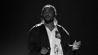 NEW YORK, NY - JANUARY 28:  (EDITORS NOTE: Image has been converted to black and white.) Recording artist Kendrick Lamar performs onstage during the 60th Annual GRAMMY Awards at Madison Square Garden on January 28, 2018 in New York City.  (Photo by Lester Cohen/Getty Images for NARAS)