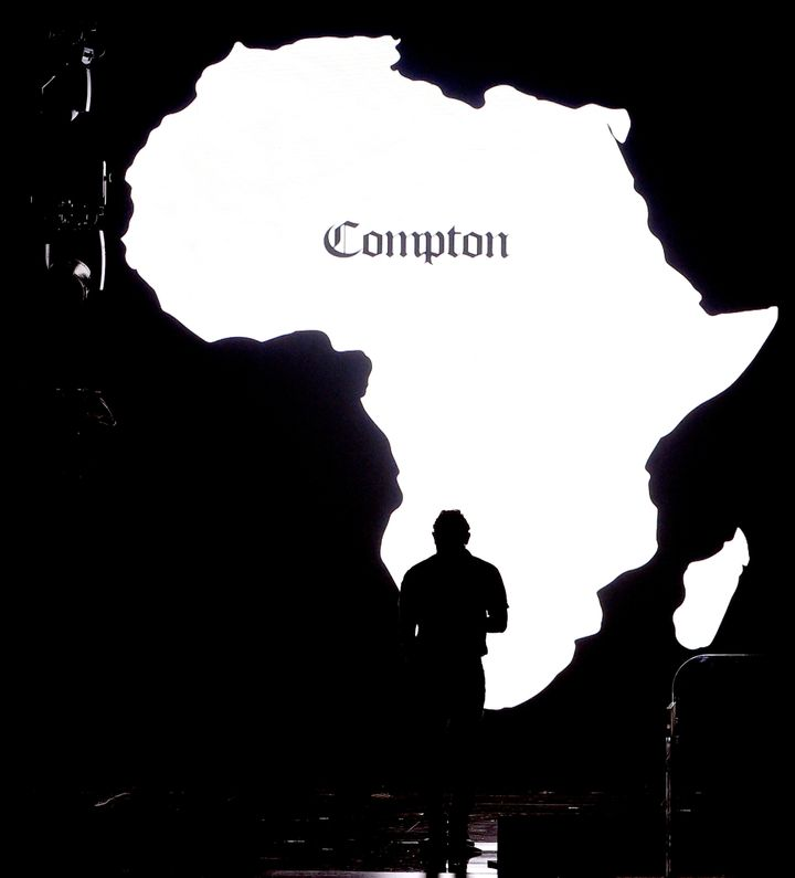 """A silhouette of Africa with """"Compton"""" written on it was projected on a video screen as Lamar performed during the 2016 Grammy"""