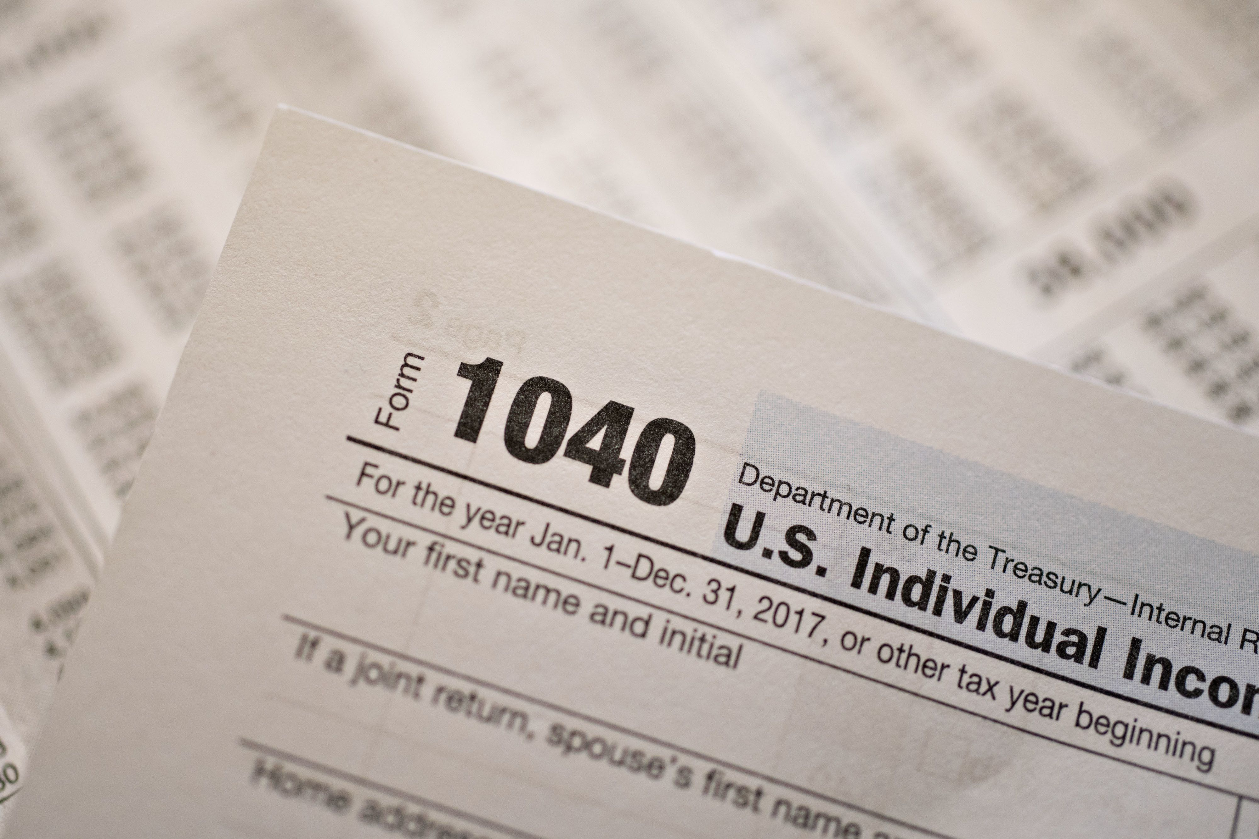 U.S. Department of the Treasury Internal Revenue Service (IRS) 1040 Individual Income Tax forms for the 2017 tax year are arranged for a photograph in Tiskilwa, Illinois, U.S., on Monday, March 19, 2018. The IRS urged taxpayers to use the Service's online tools to view the status of their federal tax account, information such as: the amount they owe or paying their tax liabilities online. Photographer: Daniel Acker/Bloomberg via Getty Images