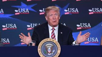 US President Donald Trump takes part in a roundtable discussion on tax reform at Bucky Dent Park in Hialeah, Florida on April 16, 2018. / AFP PHOTO / MANDEL NGAN        (Photo credit should read MANDEL NGAN/AFP/Getty Images)