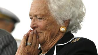 Former first lady Barbara Bush listens to remarks during the christening ceremony of the USS George H.W. Bush  at Northrop-Grumman's shipyard in Newport News, Virginia October 7, 2006. The Navy's Nimitz-class aircraft carrier is scheduled to enter service in late 2008.   REUTERS/Kevin Lamarque     (UNITED STATES)