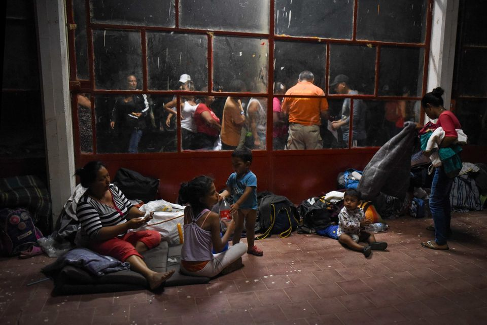 Central American migrants rest at a sports center field in Matias Romero, Mexico, on April