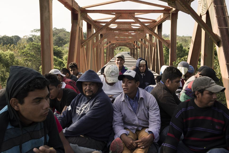 "Central American migrants ride the freight train called ""The Beast"" in Matias Romero, Mexico, on April 1."