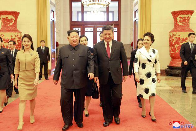 North Korean leader Kim Jong Un, his wife Ri Sol Ju, Chinese President Xi Jinping and his wife Peng Liyuan...