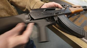 OREM, UT - FEBRUARY 21: A bump stock  is installed on an AK-47 and its movement is demonstrated at Good Guys Gun and Range on February 21, 2018 in Orem, Utah. The bump stock is a device when installed allows a semi-automatic to fire at a rapid rate much like a fully automatic gun. (Photo by George Frey/Getty Images)
