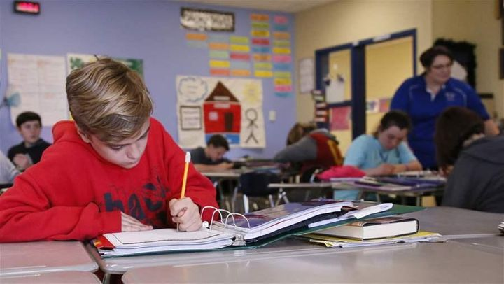 A seventh-grader in an English class in Newcastle, Oklahoma, where schools are open only four days a week. A four-day schedul