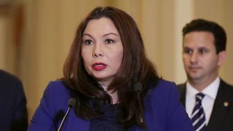 WASHINGTON, DC - NOVEMBER 07:  Sen. Tammy Duckworth (D-IL) (C) talks to reporters with Senate Minority Leader Charles Schumer (D-NY) (L) and Sen. Brian Schatz (D-HI) following the weekly Democratic policy luncheon at the U.S. Capitol November 7, 2017 in Washington, DC. The Democratic leaders were critical of the proposed Republican tax cut and reform legislation that is now working its way the House.  (Photo by Chip Somodevilla/Getty Images)