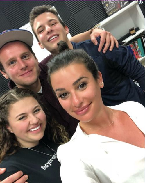 Jonathan Groff and Lea Michele pose with Stoneman Douglas school shooting survivors Sawyer Garrity, bottom left, and Cam
