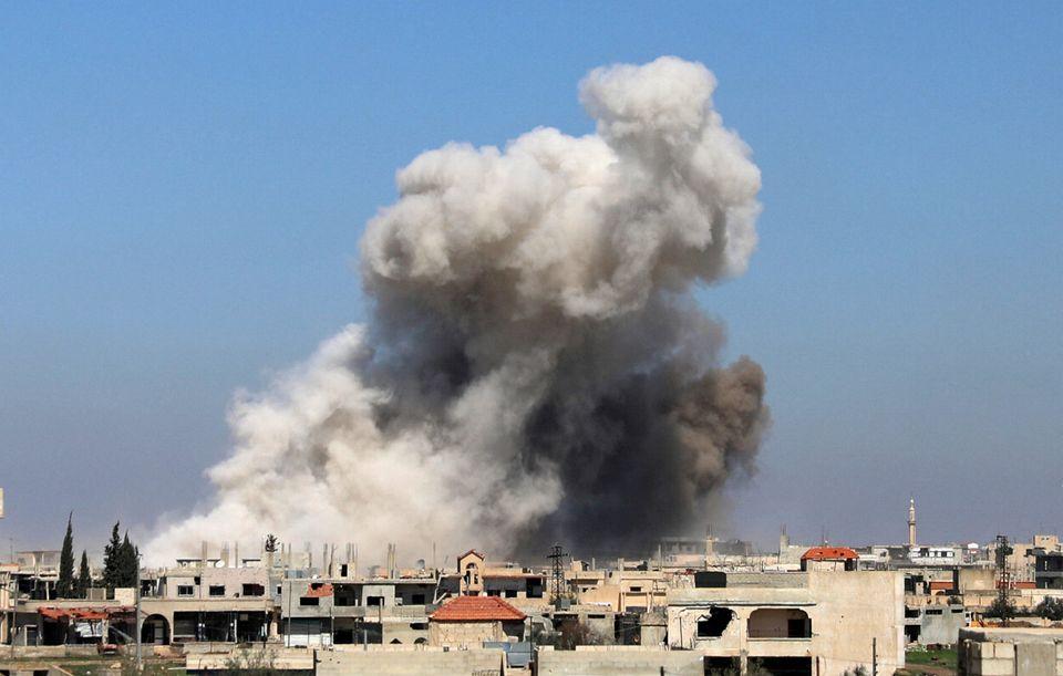 Smoke rises in Busra al-Harir town, near Deraa, Syria in