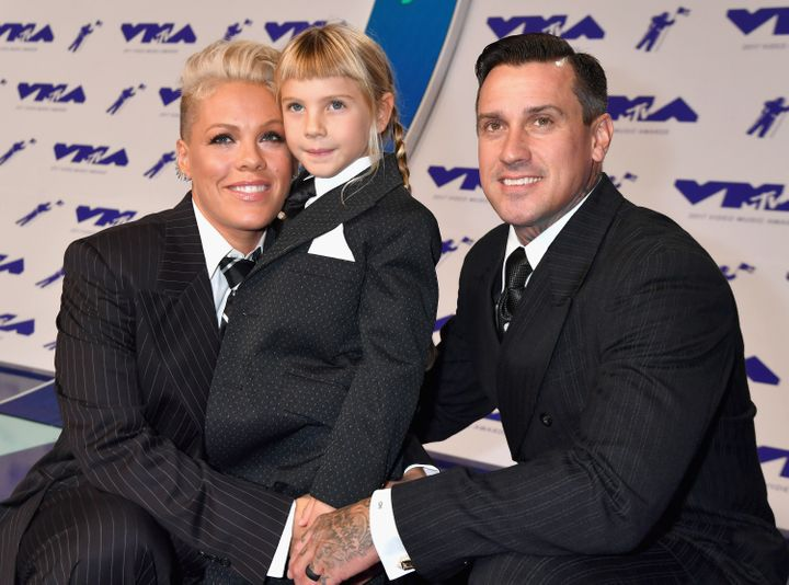 Pink at the MTV Video Music Awards in 2017 with her husband, Carey Hart, and their daughter Willow.