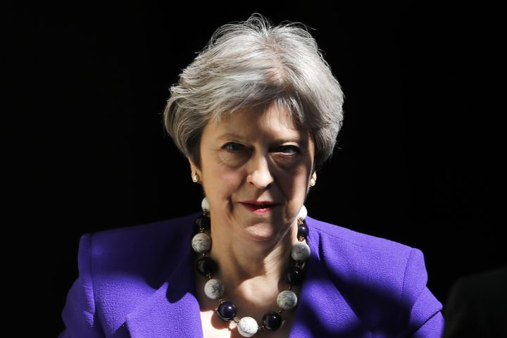 "Britain's Prime Minister Theresa May said she ""deeply"" regretted the UK's role in fueling ""discrimina"