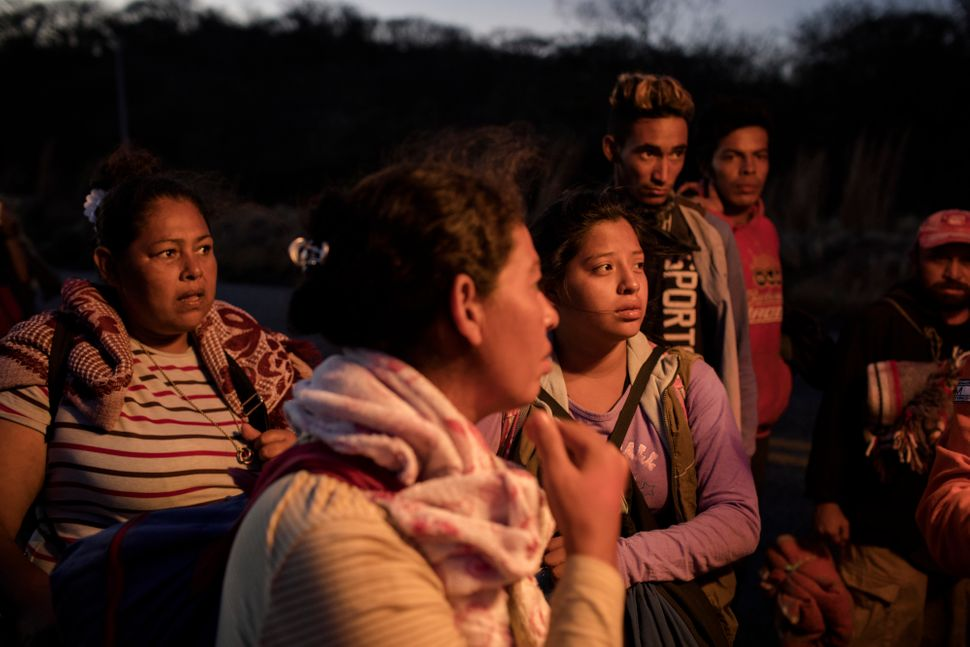 "A group of women talk with the medical attention unit of the ""refugee caravan"" heading from southern Mexico to the U.S."