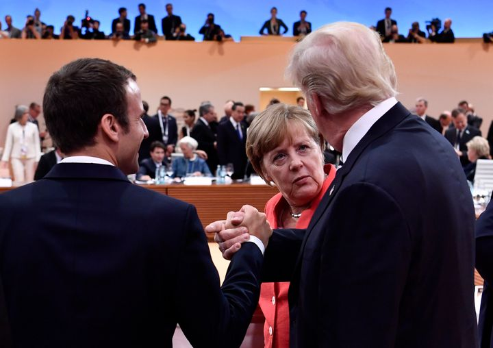 President Donald Trump alongside French President Emmanuel Macron and German Chancellor Angela Merkel at the start