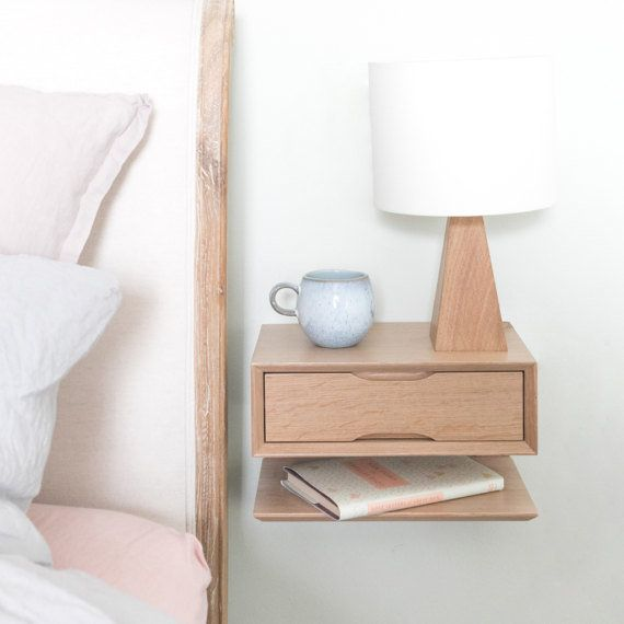 """This <a href=""""https://www.etsy.com/listing/500408310/oak-floating-bedside-table"""" target=""""_blank"""">Scandi-style floating nights"""