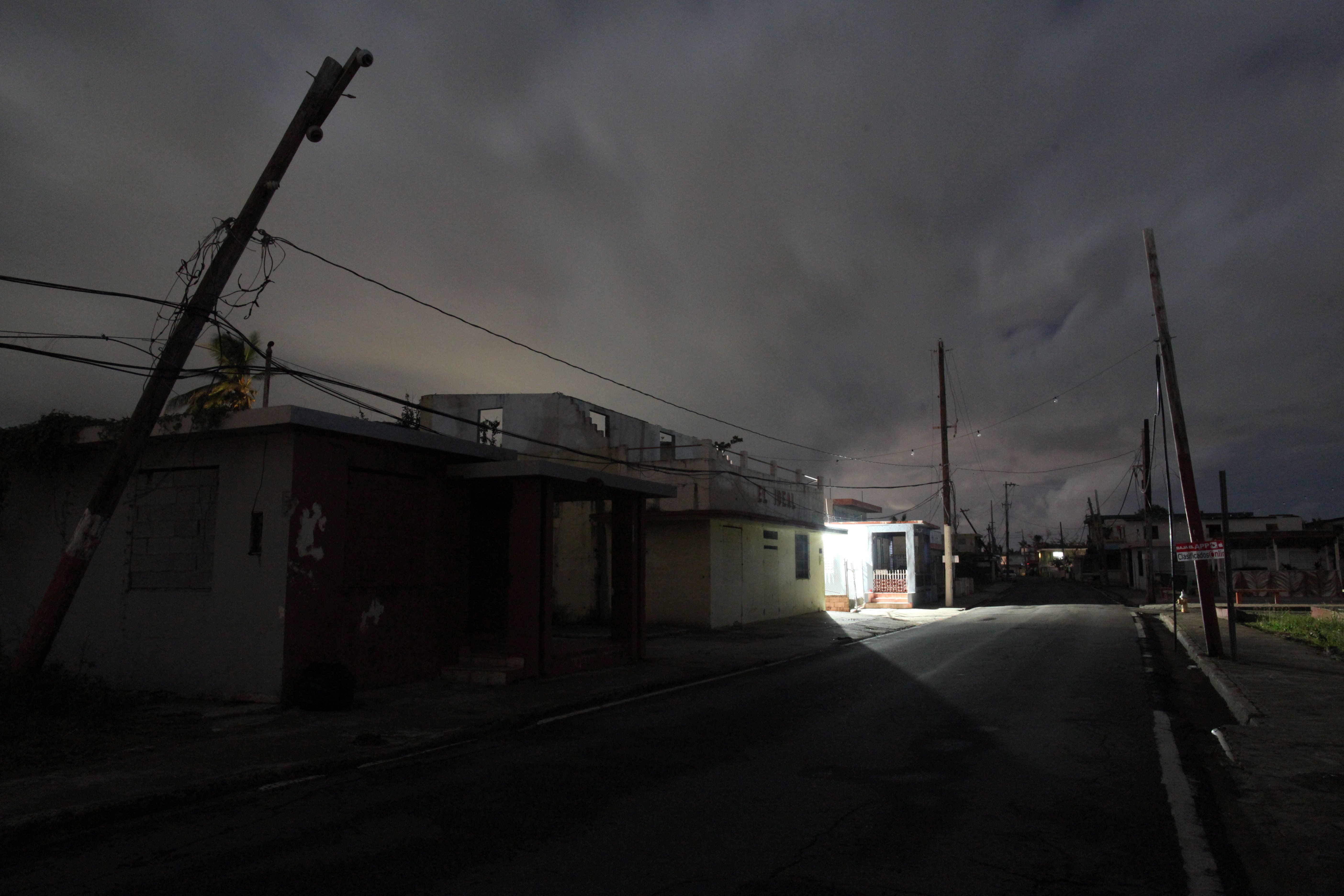A house is lit with the help of a generator, on a street in the dark after Hurricane Maria damaged the electrical grid in September 2017, in Naguabo, Puerto Rico January 25, 2018. Picture taken January 25, 2018. REUTERS/Alvin Baez
