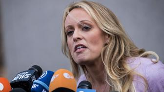 NEW YORK, NY - APRIL 16: Adult film actress Stormy Daniels (Stephanie Clifford) speaks to reporters as she exits the United States District Court Southern District of New York for a hearing related to Michael Cohen, President Trump's longtime personal attorney and confidante, April 16, 2018 in New York City.  Cohen and lawyers representing President Trump are asking the court to block Justice Department officials from reading documents and materials related to Cohen's relationship with President Trump that they believe should be protected by attorney-client privilege. Officials with the FBI, armed with a search warrant, raided Cohen's office and two private residences last week.  (Photo by Drew Angerer/Getty Images)