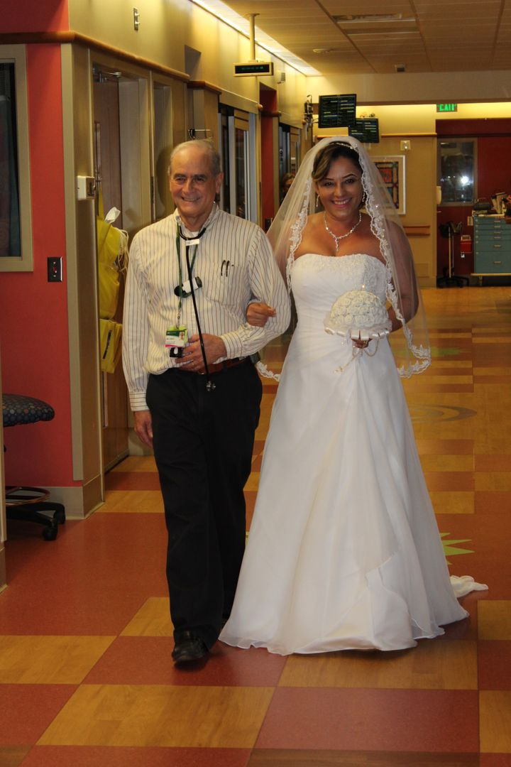 Kaelin's neonatologist, Waldemar Carlo, M.D., walked the bride down a hospital hallway.